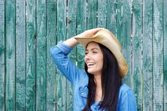 Laughing woman with cowboy hat - stock photo