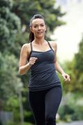 One young woman jogging outside - stock photo