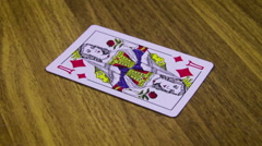 Playing Card Rotates on a Wooden Table Stock Footage