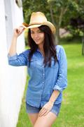Cool confident young woman with cowboy hat - stock photo