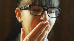 Young woman yawning Stock Footage