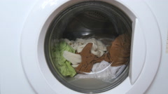 Washing machine washes clothes - front view Stock Footage