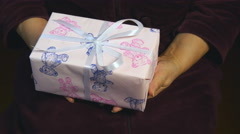 Close up, female hands giving a gift to boy. Stock Footage