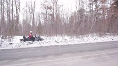 Snowmobiles driving fast  stabilized side view Stock Footage