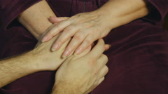 Male hand comforting an elderly pair of hands. Stock Footage