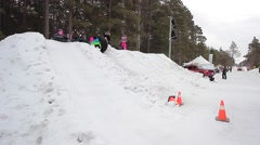 Child tubing in winter Stock Footage
