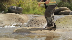 Little explorers playing with water near a river 1 - stock footage
