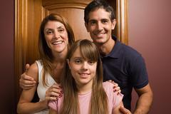 Teenage girl and parents Stock Photos