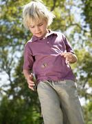 Boy with butterfly on his shirt Stock Photos