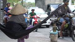 Asia inequality, poverty, selling on roadside, rush hour traffic, Vietnam Stock Footage