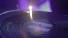 Vinyl record spinning on turntable. Audio mixer. Night club atmosphere Stock Footage