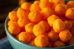 Unhealthy Cheesy Cheese Puffs Stock Photos