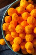 Unhealthy Cheesy Cheese Puffs - stock photo