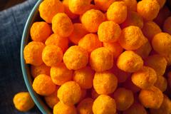 Unhealthy Cheesy Cheese Puffs - stock photo