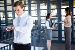 Successful businessman checking time - stock photo