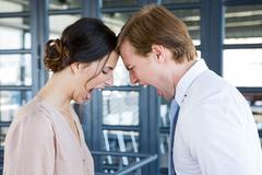 Two young business colleagues having an argument - stock photo