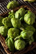 Raw Organic Green Baby Artichokes Stock Photos