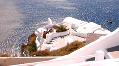 Cave houses in Oia village, next to the blue Santorini caldera. Stock Footage
