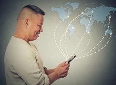 business man holding using smartphone connected browsing internet worldwide - stock photo