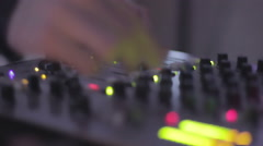 Audio equipment. DJ pushing mixing console buttons, mixing. Party atmosphere Stock Footage