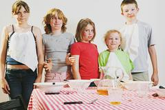 Stock Photo of Messy children looking guilty
