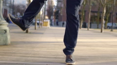 Closeup Of Man, He Jumps And Clicks His Heels Together - stock footage