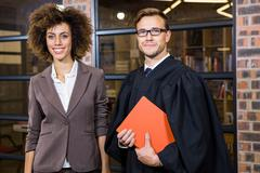 Businesswoman standing with lawyer near library Stock Photos