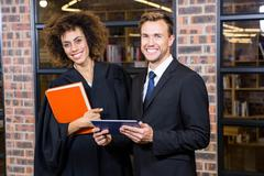 Stock Photo of Businessman and lawyer standing near library