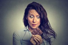 Young woman tired of diet restrictions craving sweets chocolate Stock Photos
