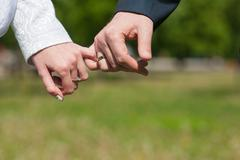 Lovers holding hands the pinky - stock photo