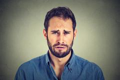 Portrait of a sad young man. - stock photo