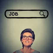 young woman in glasses smiling looking for a new job - stock photo