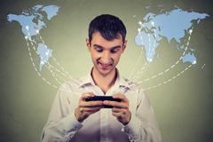 business man holding smartphone connected browsing internet worldwide - stock photo