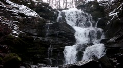 Fast Flowing Water in a Waterfall During Winter Stock Footage