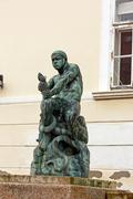 Fisherman with Snake, statue Stock Photos