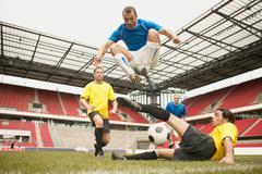 Footballers tackling Kuvituskuvat