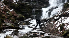 Photographer Making Photo of Winter Waterfalls in the Mountains Stock Footage