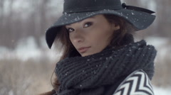 Young beautiful elegant model posing over winter background. Stock Footage