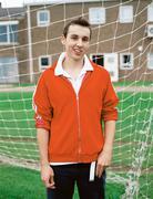 Boy standing in goal Stock Photos