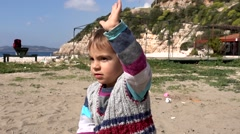 Child waving bye-bye Stock Footage