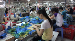 Industrial Vietnam, people work at production line of clothing company Stock Footage