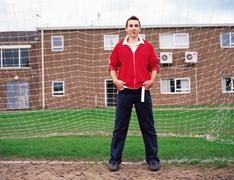 Teenage boy standing in goal Stock Photos