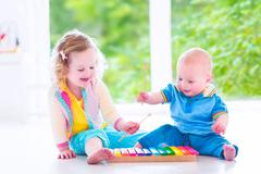 Kids playing music with xylophone Kuvituskuvat