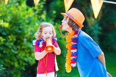 Two kids Dutch football supporters - stock photo