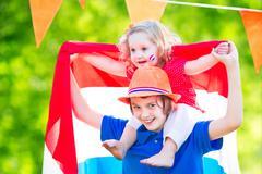 Two kids Dutch celebration national holiday - stock photo