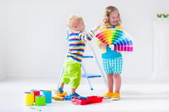 Children painting walls at home remodel - stock photo