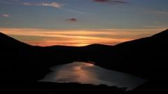Dramatic sunset over Talla Reservoir, Scottish Borders Stock Footage