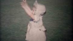 1948: Baby girl runs to dad's embrace and safety loving kisses. Stock Footage