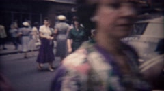 1948: Busy people cross downtown city shopping district streets. - stock footage