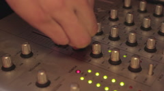 Close-up of deejay's hands playing cool music and pushing mixer buttons. Party - stock footage